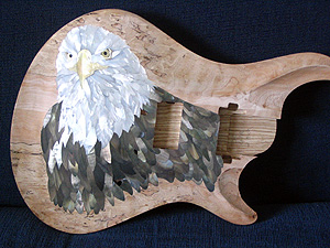 Inlay of an Eagle's head, one of the largest of guitar inlays, covering almost the entire front of the body